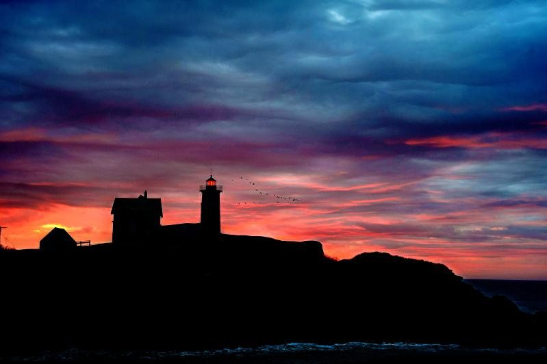 A lighthouse sunset in Portland, Maine.