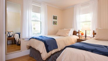 two twin beds in a light filled room