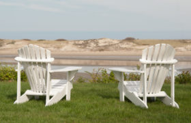 White Adirondack chairs at The Dunes.